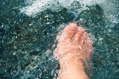 Women foot, refreshing and hardening in a mountain brook Stock Images