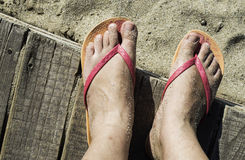 Women foots on the beach Royalty Free Stock Photo