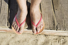 Women foots on the beach Royalty Free Stock Photos