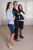 Women in formal clothes of different heights are crossed hands o Stock Photo