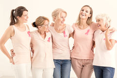 Women from foundation. Group of positive women from anticancer foundation hugging together stock photos