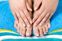 Women french manicure. Womens feet and arms with french manicure stock photos