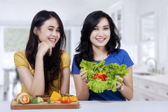 Women with fresh and healthy food Royalty Free Stock Photos
