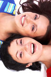 Women friends. Happy young women friends laughing. Over white background royalty free stock photo