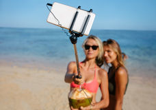 Women friends on beach holiday taking selfie Stock Photography