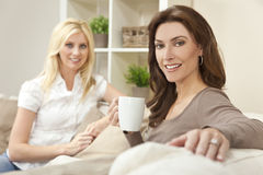 Women Friends Drinking Tea or Coffee at Home Royalty Free Stock Photos