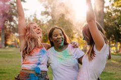 Friends enjoying holi outdoors having fun royalty free stock photography
