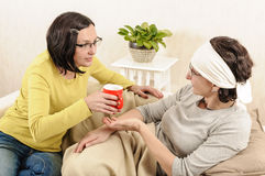Women friends family care cup hot tea Royalty Free Stock Images