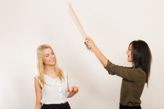 Women friends having fun blowing wind Stock Images