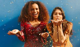 Women friends having fun with glitters stock images