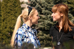 Women friends meet in a park. Two women friends meet in a city park Royalty Free Stock Photography