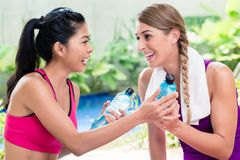 Women friends relaxing after fitness exercise stock photo