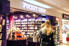 Women In front of a bookshop at the airport. Women standing in front of the bookshop pocket shop at Arlanda airport in Sweden stock images