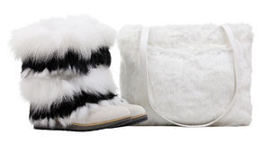 Women fur boots and fur shoulder bag over white Royalty Free Stock Images