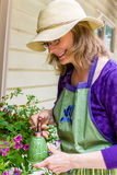 Women Gardening in Backyard Royalty Free Stock Images