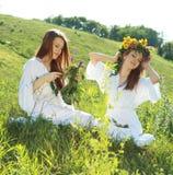Women garlanding flowers Royalty Free Stock Images