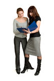 Women get acquainted oneself with the document. Royalty Free Stock Photos