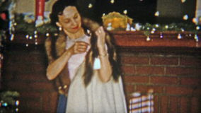 1954: Women gets mink fur stole for Christmas gift. NEWARK, NEW JERSEY