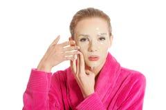 Women getting facial mask Stock Photo