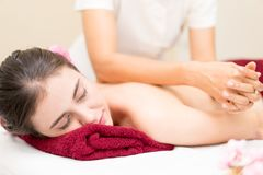 Women is getting her Back massage on a bed Stock Photo