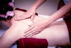 Women is getting oil Massage. On her back royalty free stock images