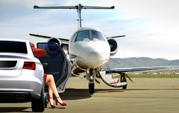 Women getting ready to boarding a private jet Stock Photo