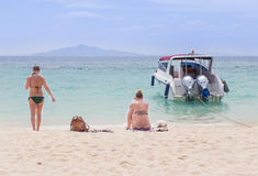 Women and girlfriend relaxing on the tropical beach and sea Stock Photography