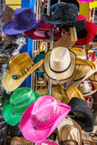 Women and Girls Stylish Cowboy Hats. Women and girls fashionable and colorful cowboy hats for tourists displayed on a hat rack in El Mercado royalty free stock images