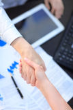 Women give handshake after agreement. Two women give handshake after agreement Royalty Free Stock Photos