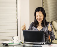 Women gives Thumbs Up for Great Work Stock Images