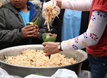 Women giving Thai stir-fried noodles to children Royalty Free Stock Images
