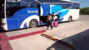 Women giving their luggages to the bus assistant at Eskisehir Bus Terminal. Eskisehir, Turkey - August 13, 2018: Unidentified people giving their luggages to the stock video footage