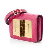 Women glamorous pink bag made of crocodile leather. Royalty Free Stock Images