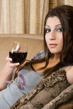 Women and glass of wine. Women laying in a couch with wine glass Stock Photos