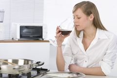 Women with glass of wine Stock Images