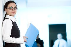 Women in glasses with blue folder. For pepers stock photography