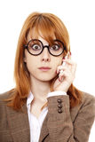 Women in glasses calling by phone. Royalty Free Stock Photo