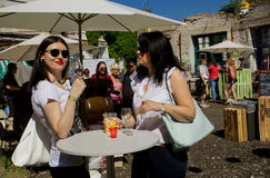 Women in glasses drinking wine at outdoor bar Stock Photography