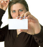 Women in glasses shows empty white card Royalty Free Stock Photography