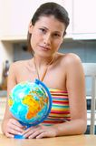 Women with globe. Young woman with globe on the table Royalty Free Stock Photo