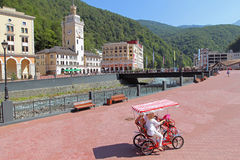 Women go on a four wheeled bike in Rosa Khutor, Sochi, Russia Stock Photos