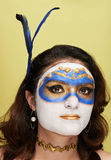 Women with gold mask. Body art on yellow background stock photos