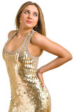 Women in a golden dress. The young beautiful women in a golden dress. Isolation on a white background Stock Photos