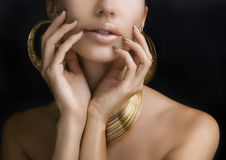 Women with Golden Make-up, Hands with Golden Manicure. Makeup, B. Beautiful Women Lips with Stylish Golden Shiny Lipstick and Hands with Golden Manicure and Gold royalty free stock image
