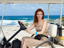 Women by golf car on the seashore. Mexico. Royalty Free Stock Photos