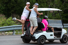 Women on a golf cart. Royalty Free Stock Photos