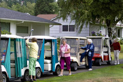 Women and Golf Carts Royalty Free Stock Photography