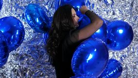 Women in good mood among inflatable balloons at evening event. Women in good mood among inflatable balloons on background of silver wall at evening event stock video