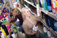 Women in good spirits selecting detergents in the store Royalty Free Stock Image