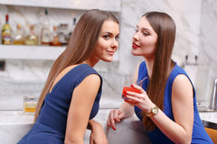 Women gossip in the bar Royalty Free Stock Photography